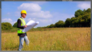 Image of Land Surveyor in Open Field